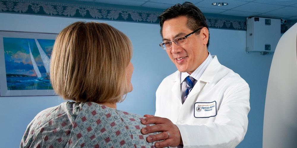 Dr. Lawrence Chin with patient