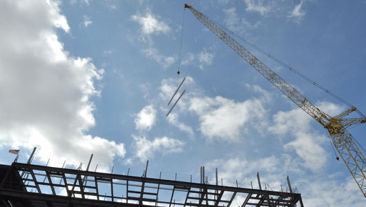 Signed beams placed, represent the heart and soul of Upstate Cancer Center