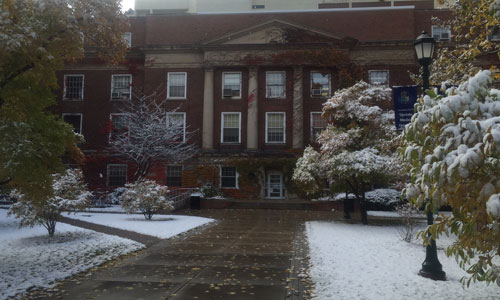 Early snow paints Weiskotten Hall courtyard white