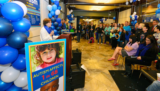 Upstate autism expert Carroll Grant addresses the crowd gathered at our World Autism Day celebration in Onondaga Tower lobby.