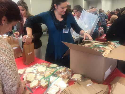 In spirit of giving, Upstate prepares 1,300 lunches for the Rescue Mission
