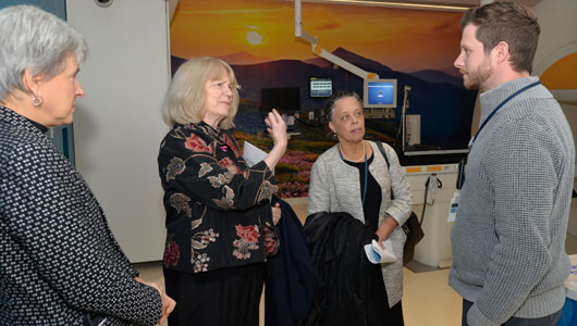 Genticist Mary-Claire King tours Upstate Cancer Center