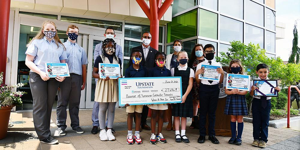 The money was raised in May as each school held a walkathon to raise the funds.