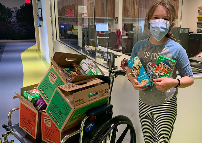 A GENEROUS GIFT! Nine-year-old patient Maeve Raebognar donated four cases of Girl Scout cookies to staff at Upstate's Center for Children's Cancer and Blood Disorders March 26. Thank you for this thoughtful gesture, Maeve!