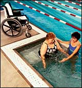 A WEALTH project participant with University Hospital Physical Therapist in the Institute's wheelchair-accessible, adjustable bottom pool.